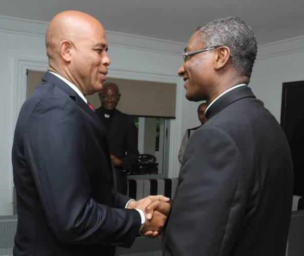 President Martelly and Monsignor Langlois