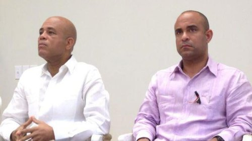 President Martelly and former Prime Minister Lamothe not looking too happy.